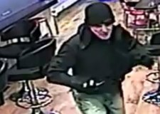 Video: Armed robber jumps the counter of Stamford betting shop to steal cash