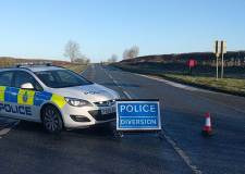 Two men die after A153 crash