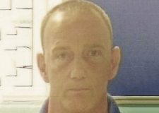 Police hunt for prison absconder