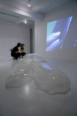 Third & Second, 2007, digital video projection. First, 2007, fiberglass, 430 x 120 cm. Photo by Suemasa Mareo