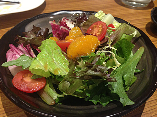 House salad with sesame ginger dressing (included with entree) at Sakai Sushi Bar in Spruce Grove!