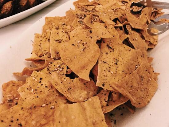 Marinated Feta on Za'atar Pasta Roller Cracker.