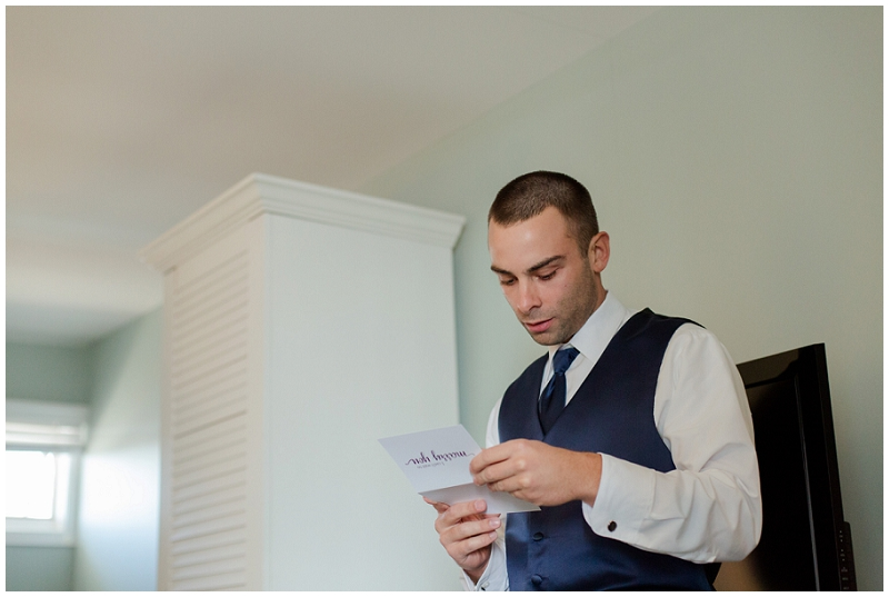 Melanie and Mike were married at Clay Hill Farm in Cape Neddick Maine. Click here to see more beautiful photos by Linda Barry Photography of their burgandy and navy wedding day! Groom reading letter from his bride.