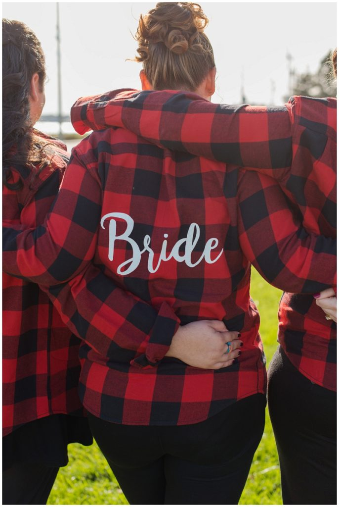 Melanie and Mike were married at Clay Hill Farm in Cape Neddick Maine. Click here to see more beautiful photos by Linda Barry Photography of their burgandy and navy wedding day! Monogrammed flannel shirt for the bride and bridesmaids.