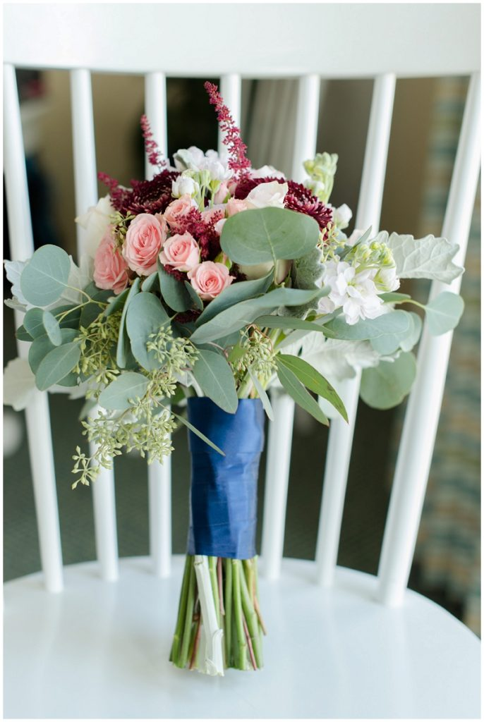 Melanie and Mike were married at Clay Hill Farm in Cape Neddick Maine. Click here to see more beautiful photos by Linda Barry Photography of their burgandy and navy wedding day! Bouquet arrangmeents.