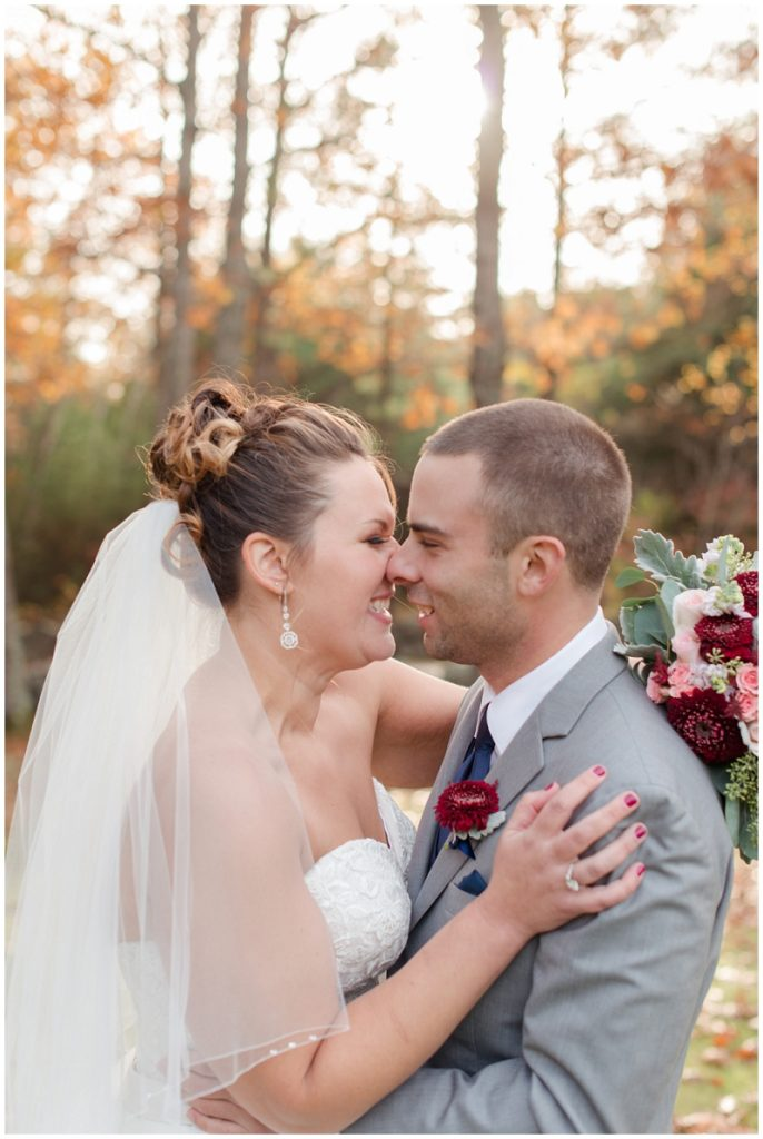 Melanie and Mike were married at Clay Hill Farm in Cape Neddick Maine. Click here to see more beautiful photos by Linda Barry Photography of their burgandy and navy wedding day! Bride and groom photos in the fall.