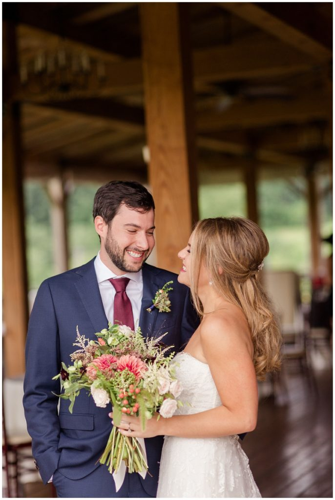 A beautiful photo of the bride and groom on the patio of the Barn at Gibbet Hill. Photos by Linda Barry Photography, a Boston based wedding photographer.