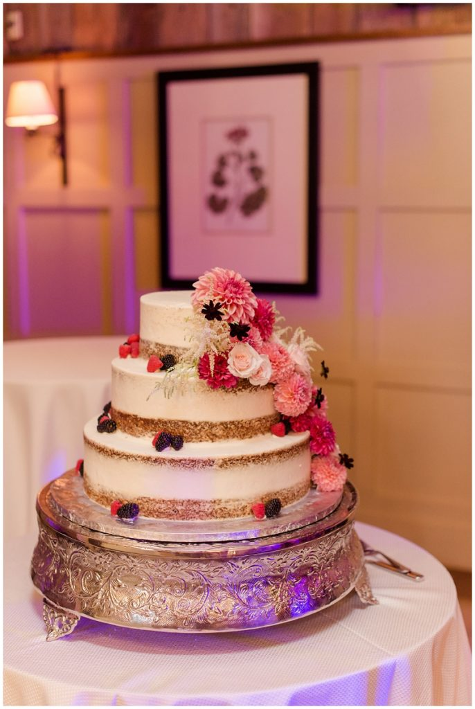 Floral and berry wedding cake.