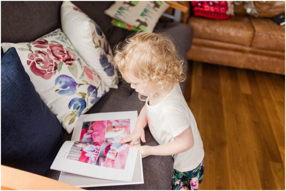 Lily looking at our blurb photo books