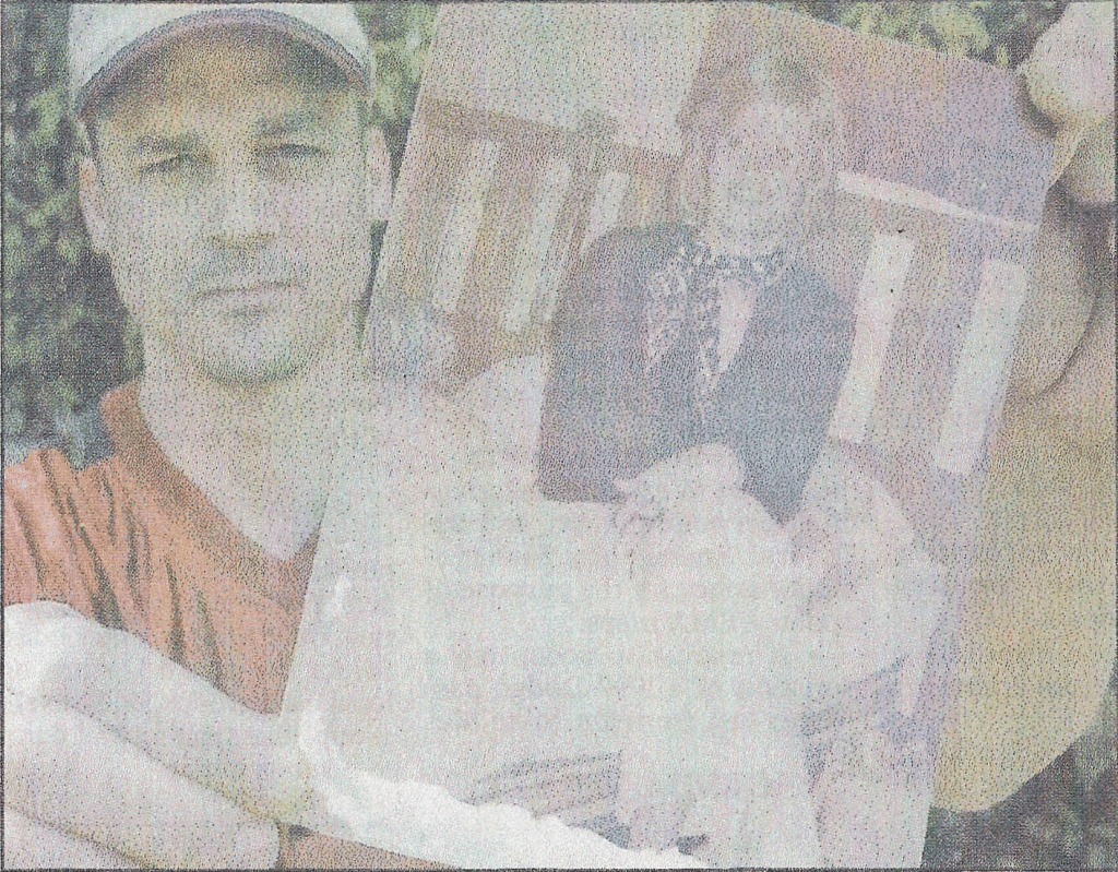 WANTS MYSTERY SOLVED: Toby Edwards, holding a photo of his mother, Linda, still hopes to have his mother's murder solved. Linda Edwards, a former Garland County Sheriff's Department radio operator, was killed 30 years ago and her killer has never been brought to justice. The Sentinel•Record/Richard Rasmussen