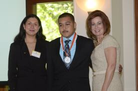 Dr. Glessner with Gisela Greco-Llamas and Exemplary Migrant Student Aaron Mejia.