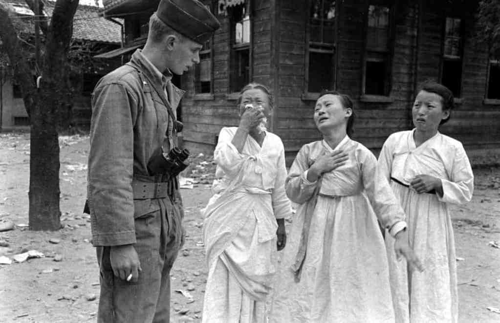 Grieving South Korean women and an international observer seen during a communist uprising, 1948.  Read more: Korea Divided: Photos From the October 1948 Yeosu-Suncheon Rebellion | LIFE.com