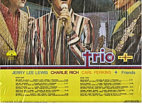 Trio Orion album back cover showing Elvis's silhouette in background