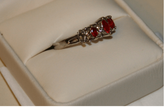 Jesse's mother's ruby ring showing stone missing