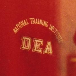 Red DEA Suit at Graceland logo enlarged