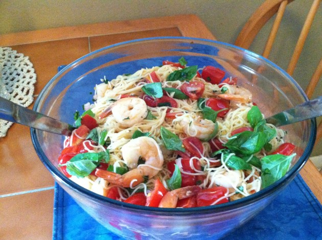 Spaghetti with a shrimp,tomato,and basil tossed in a Dijon vinaigrette.