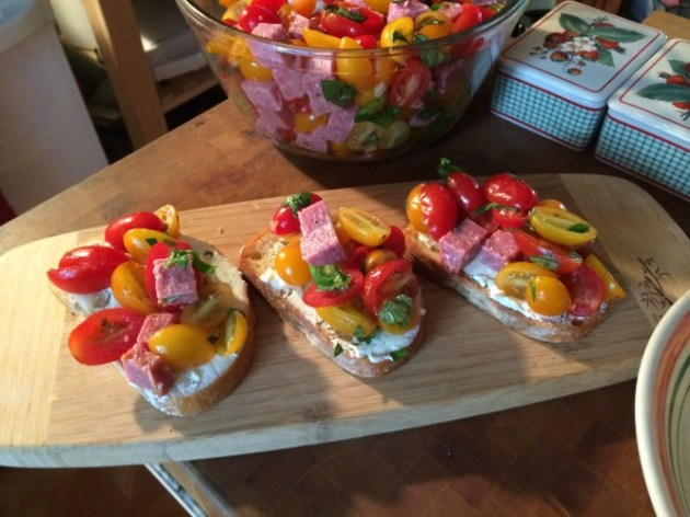 Crostini Topped With A Grape Tomato Salad