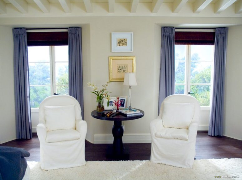 The Holiday LA House Sitting area blue chairs blue drapery white walls Cameron Diaz Kate Winslet