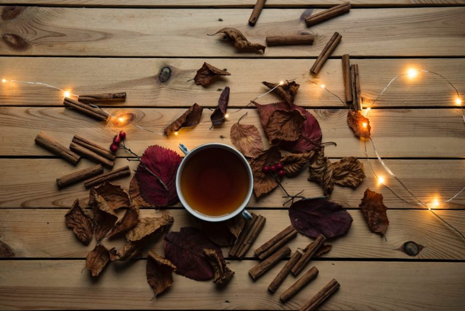 Fall spices and a cup of tea on a table top