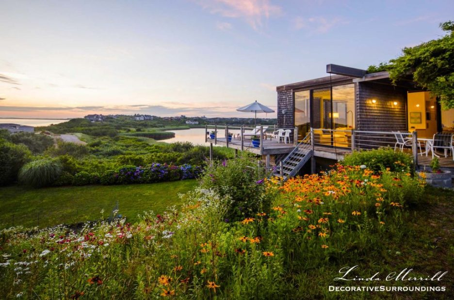 Design by Linda Merrill Decorative Surroundings: Modern Beach house overlooking a lawn of wildflowers, a small pond and the Atlantic Ocean.