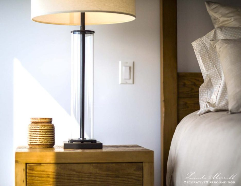 Design by Linda Merrill Decorative Surroundings: Modern beach house in Truro, MA on Cape Cod rustic side table, Restoration Hardware table lamp, beige silk bedding