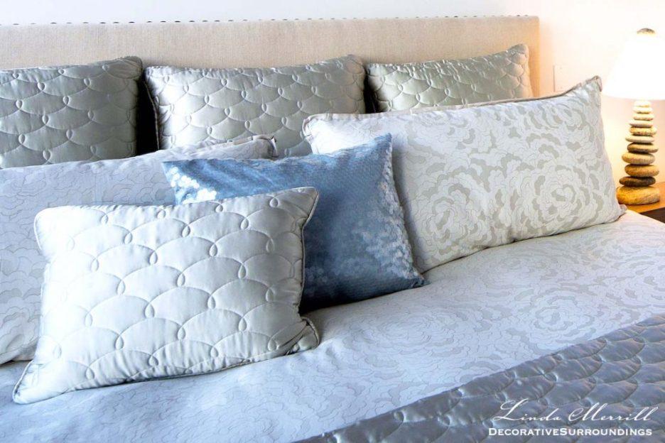 Modern Coastal House bedroom in Truro, Massachusetts with blue silk bedding, beige linen headboard with nailhead trim.