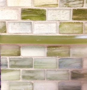 Luanda Bay Tile glass mosaic tile in green and blues.