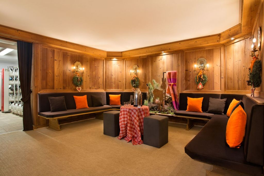 Cristallo Resort hotel lounge with bench seats and paneled walls