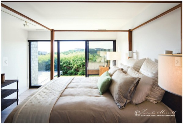 A serene modern coastal bedroom in Truro Massachusetts design by Linda Merrill. Interior design and decorating services