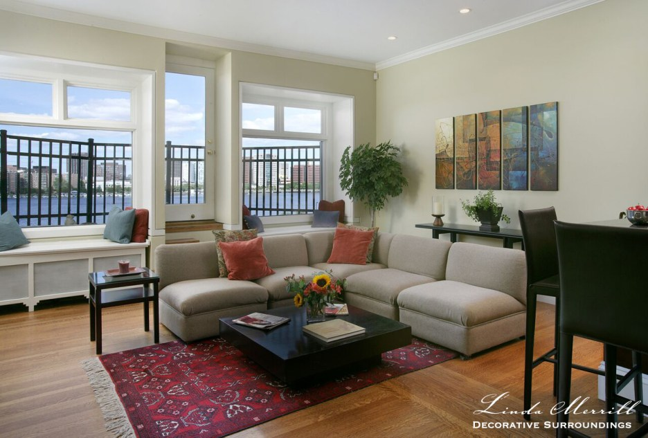 Back Bay Boston living room, Beacon Street, Charles River, red Oriental carpet, modern furnishings, beige, red and green palette, window seats, leather barstools