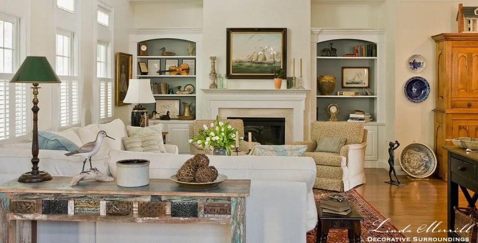 Classic Coastal nautical living room with white sofa, ships painting