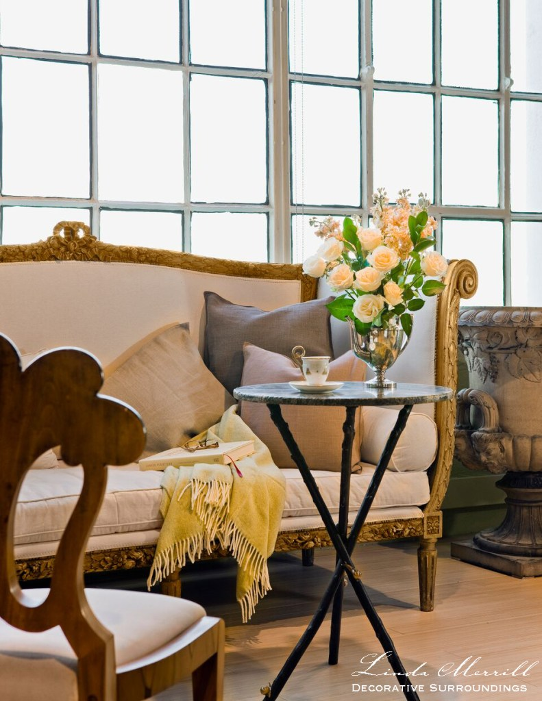 Editorial images Design by Linda Merrill Decorative Surroundings: A loft style vignette with gilded French sofa, Biedermeier chair, small side table,