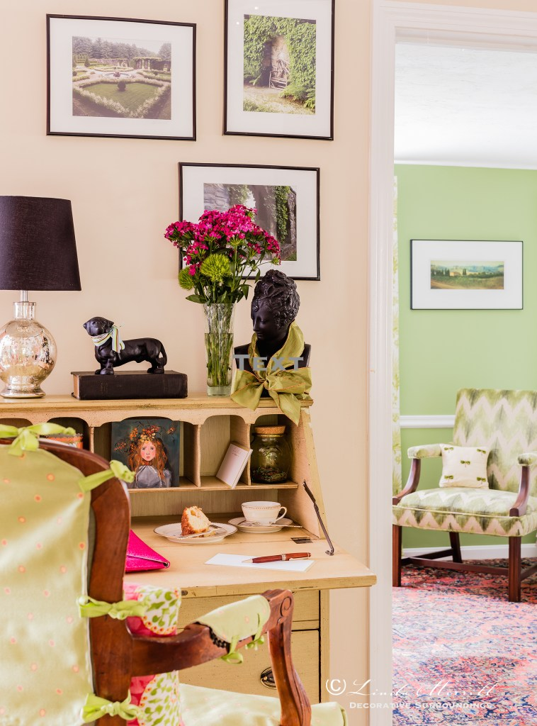 Design by Linda Merrill Decorative Surroundings: Colorful waterfront cottage A small antique green painted desk with French arm chair looking into a room with a green cut velvet upholstered chair.  Massachusetts 02332