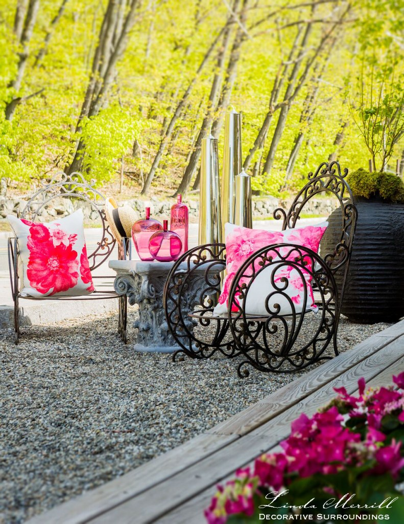 Editorial images Design by Linda Merrill Decorative Surroundings: Outdoor sitting area with wrought iron furniture, pink flowers and pillows and glassware