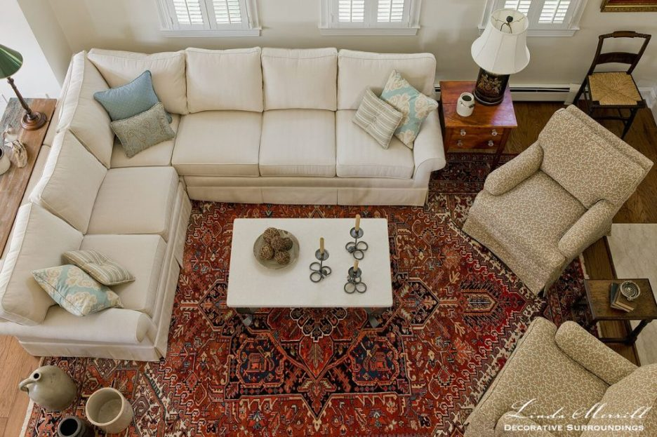 Design by Linda Merrill Decorative Surroundings: Coastal Home living room in Duxbury MA with white sectional arm chairs antiques red oriental carpet