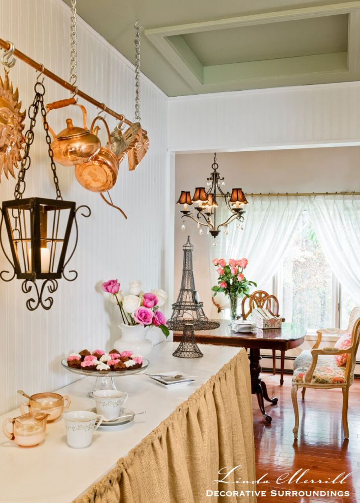 Design by Linda Merrill Decorative Surroundings: French country kitchen with burlap counter skirt, copper pots, green painted cabinets, black and white checkerboard floors.