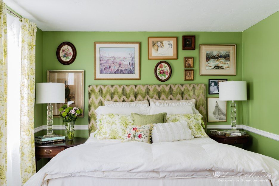 Design by Linda Merrill Decorative Surroundings: Colorful waterfront cottage A green and white bedroom with upholstered headboard, white linen bedding  Massachusetts 02332