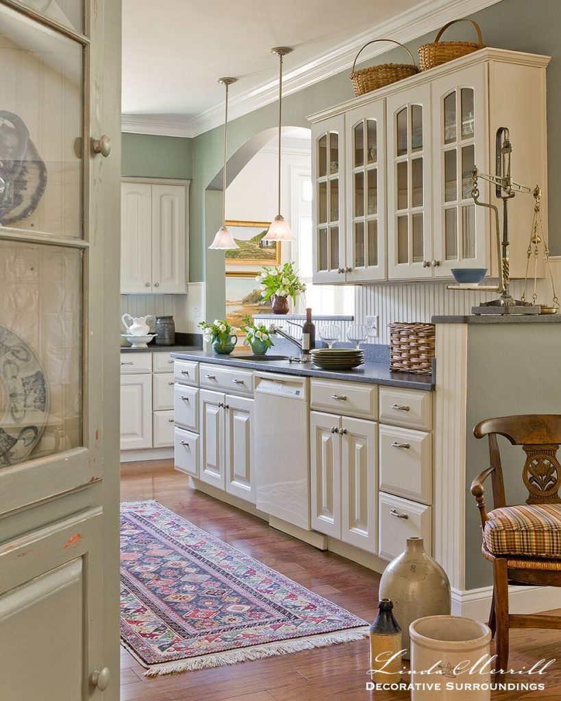 Design by Linda Merrill Decorative Surroundings: Coastal Home kitchen in Duxbury MA white cabinets headboard cabinet oriental carpet antiques baskets