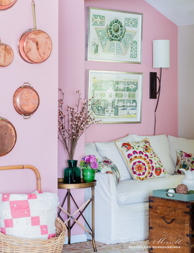 Design by Linda Merrill Decorative Surroundings: Colorful waterfront cottage A pink living room with white linen sofa, copper pots, colorful pillows.  Massachusetts 02332
