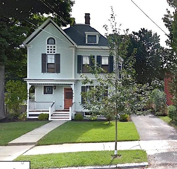 Light green Victorian house