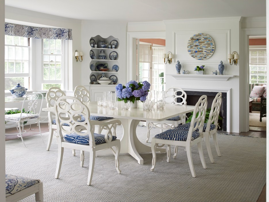 the Hamptons White dining room with white dining table and chairs, blue zebra chair fabric, blue and white china, blue and white valance, white rug
