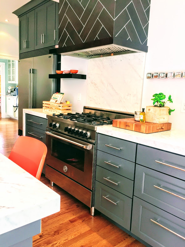 Kitchen with gray cabinets, white marble counters with mitered edge, orange chairs, Kitchen Massachusetts