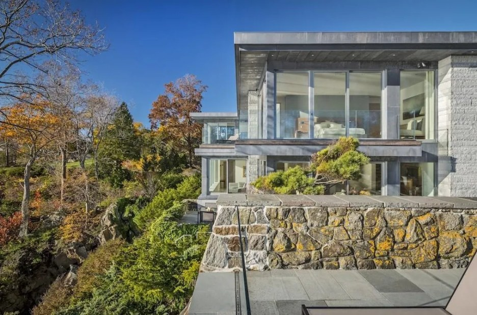 Spectacular oceanside modern beach house in Manchester-By-The-Sea Massachusetts. #modern #beach #coastal #home #oceanside #views #stone #glass #exteriors