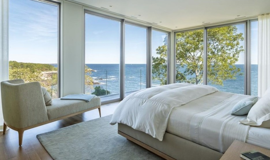 Spectacular oceanside modern beach house in Manchester-By-The-Sea Massachusetts. #modern #beach #coastal #home #oceanside #views #stone #glass #bedroom