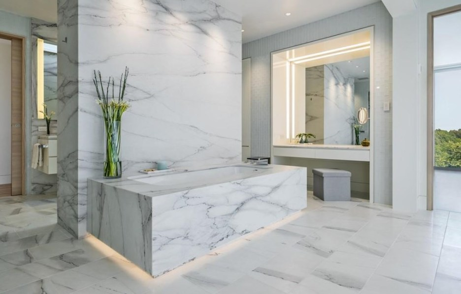 Spectacular oceanside modern beach house in Manchester-By-The-Sea Massachusetts. #modern #beach #coastal #home #oceanside #views #stone #glass #bathroom #masterbaths #master #marble #tub #lighting #marble #slab