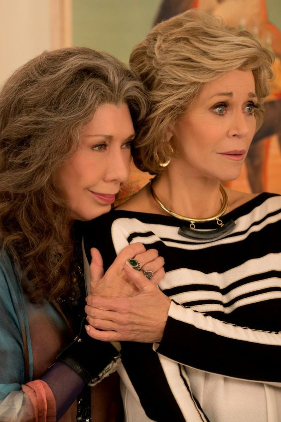 Grace and Frankie besties holding hands