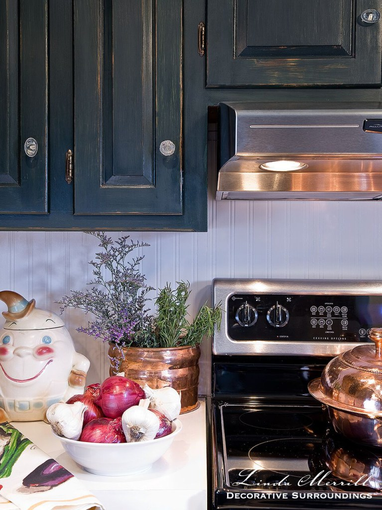 Form vs. Function Linda Merrill French country kitchen cooktop green painted cabinets copper ventilation hood