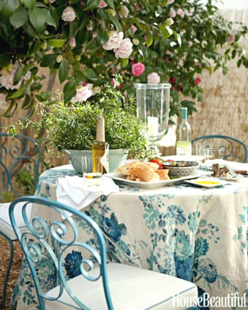 House Beautiful blue wrought iron table and chairs with Clarence House linens