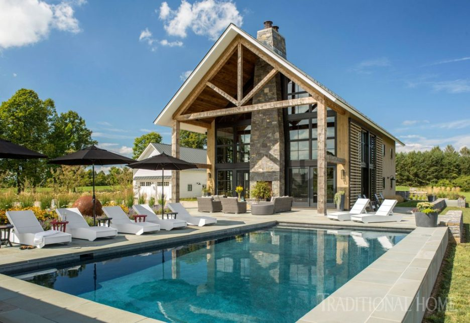 Vermont Farmhouse Fantasy Lillian August Traditional Home Exterior pool glass and slate wall
