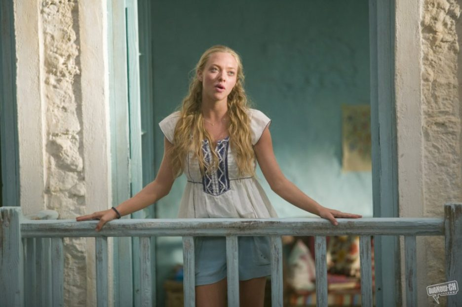 Mamma Mia Amanda Seyfried sining on blue painted balcony blue bedroom stucco walls